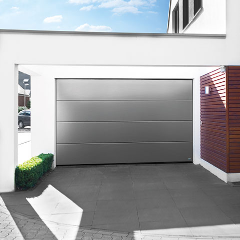 Grey sectional garage door on high end residential property