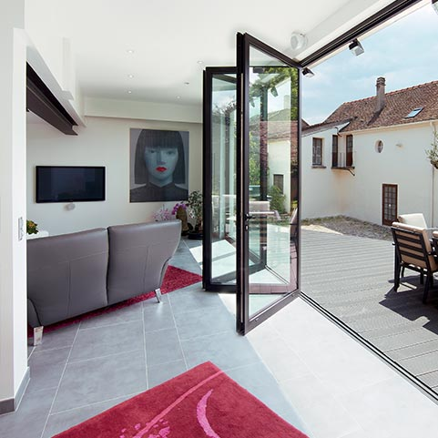 Aluminium sliding folding doors with slim sightlines that create a premium look