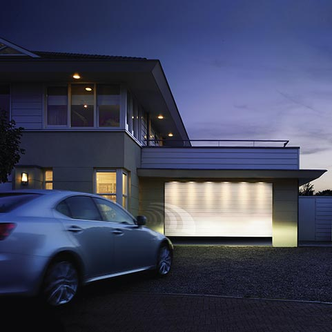 Sectional garage that opens automatically from car on arrival